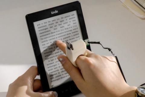 Finger-mounted reading device